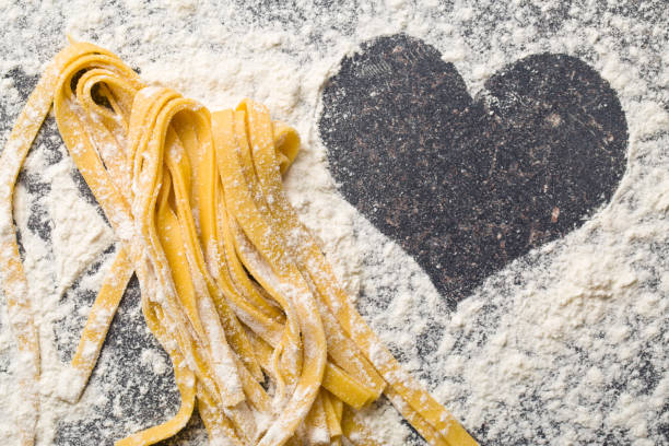 pasta and heart the homemade pasta and heart tagliatelle stock pictures, royalty-free photos & images