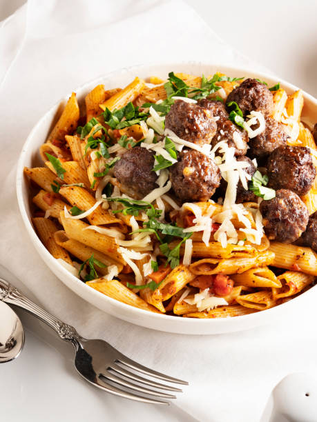 pasta and meatballs, Penne pasta with meatballs in tomato sauce, Penne Pasta with meatballs stock photo