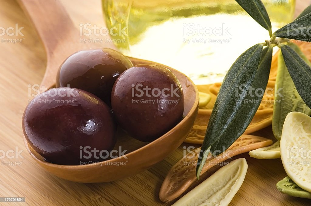 pasta, black olives, oil with fresh branch. food ingredients royalty-free stock photo