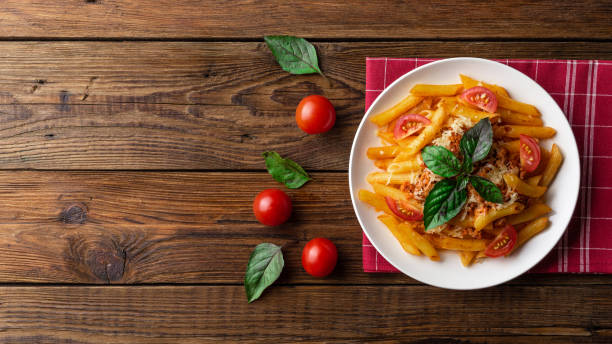pasta bolognese with tomato sauce and minced meat. flat lay. top view. - looking at view stock pictures, royalty-free photos & images