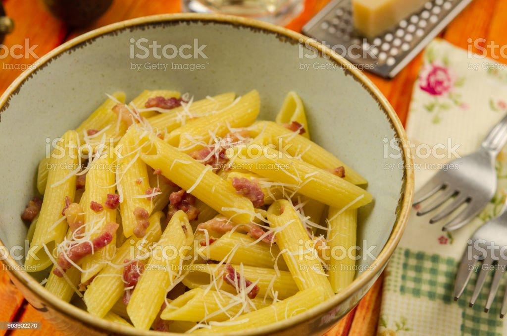 Pasta carbonara. Italian pasta with bacon. Penne alla carbonara - Royalty-free Bacon Stock Photo