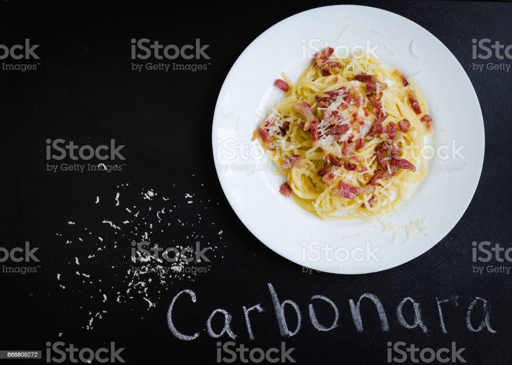 Pasta Carbonara. Spaghetti with bacon and parmesan cheese. stock photo