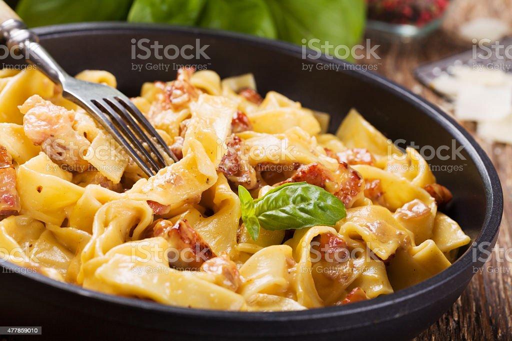 Pasta Carbonara with bacon, basil and cheese stock photo