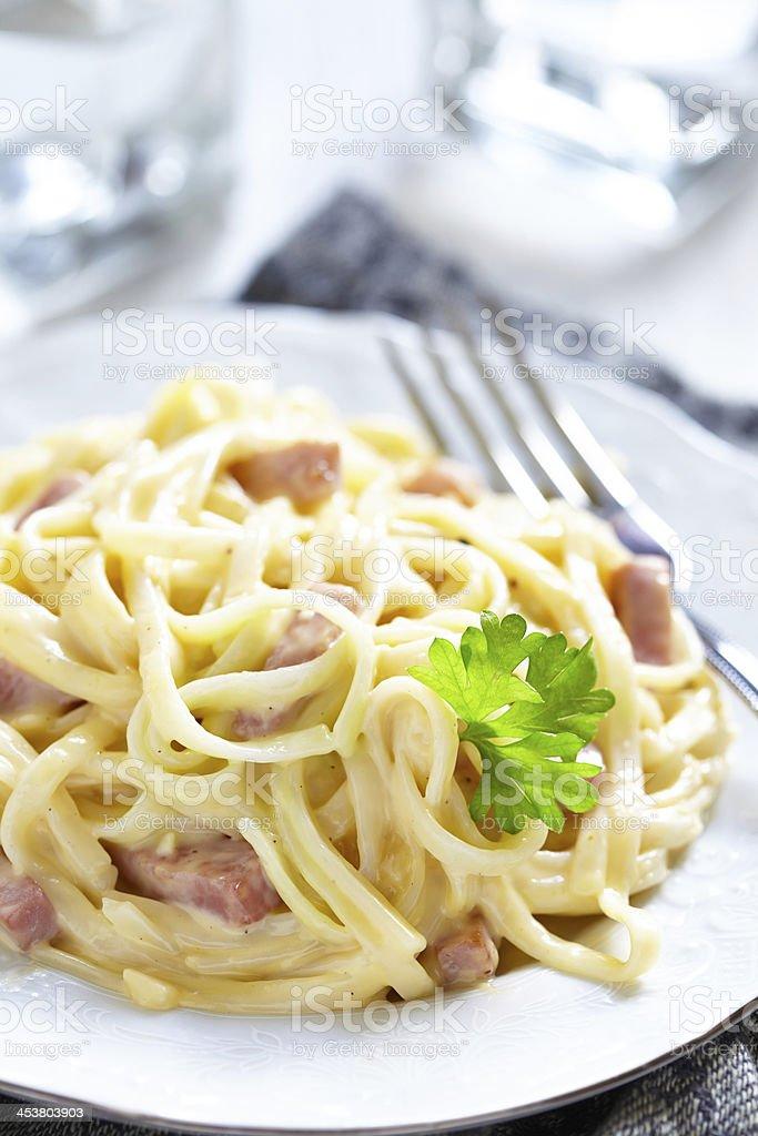 Pasta Carbonara with ham and cheese stock photo