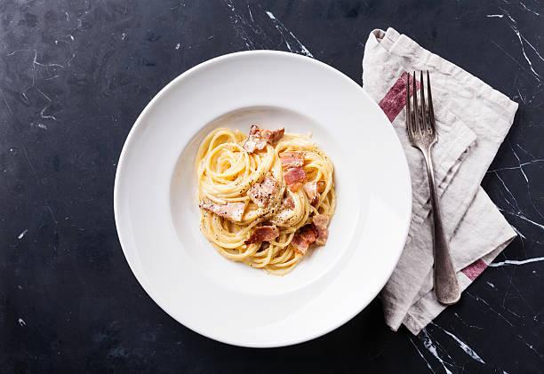Pasta Carbonara with parmesan stock photo