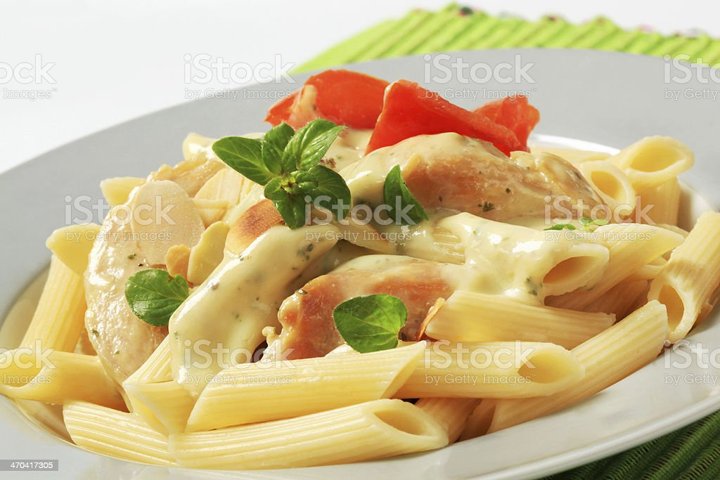 Pasta, chicken meat and cream sauce stock photo