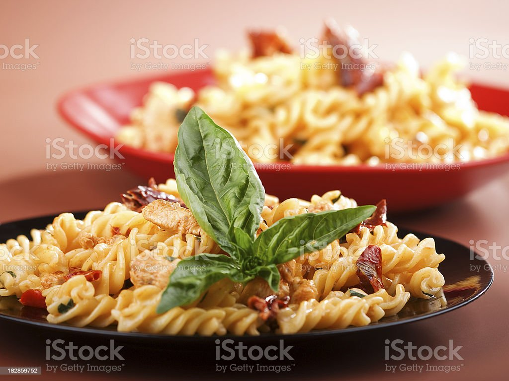 Pasta Collection - Fusilli with salmon and dried pepper stock photo