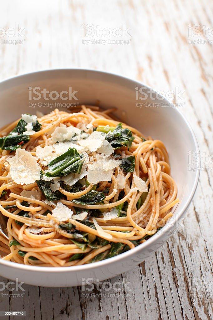 Pasta dish on white weathered wood stock photo