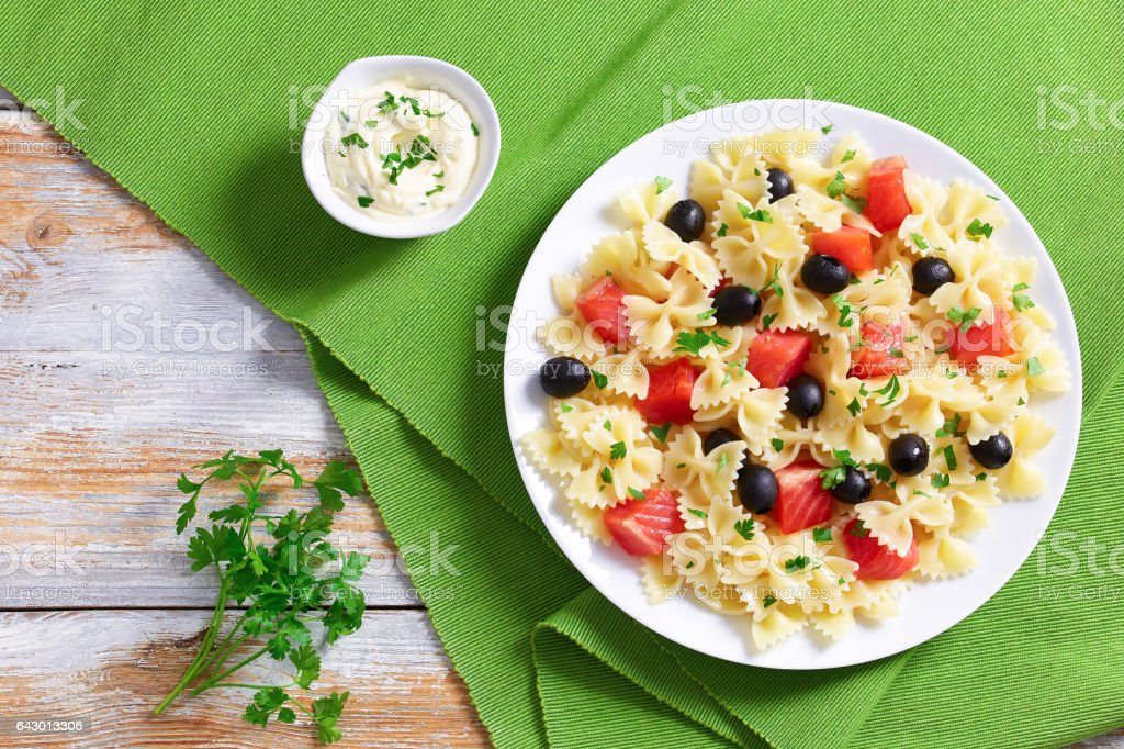pasta Farfalle with Smoked Salmon and black olives stock photo