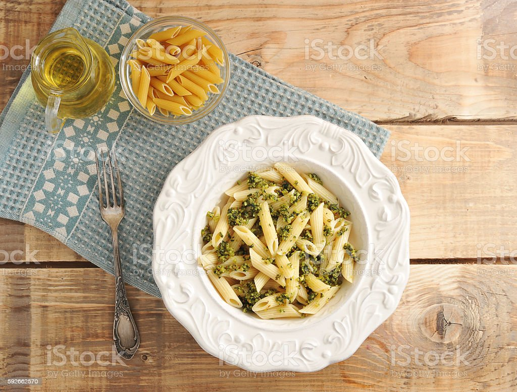 pasta feathers with sauce pestle in plate stock photo