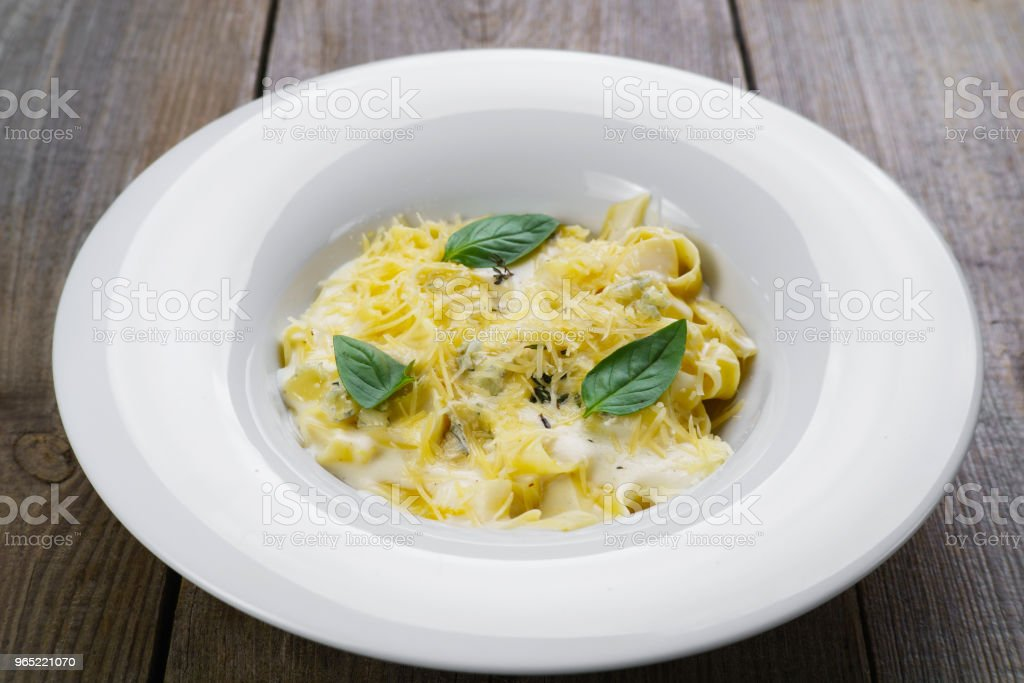 Pasta Fettuccine with bechamel sauce and parmesan royalty-free stock photo
