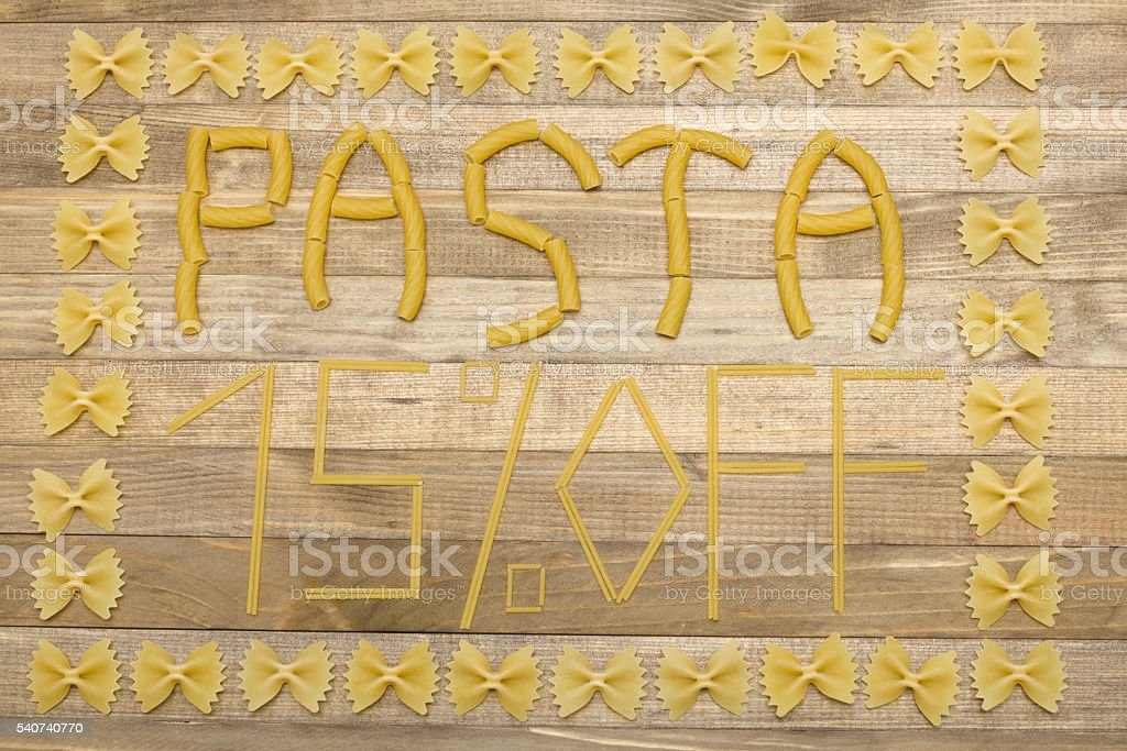 pasta  fifteen  percent off text made of raw pasta stock photo