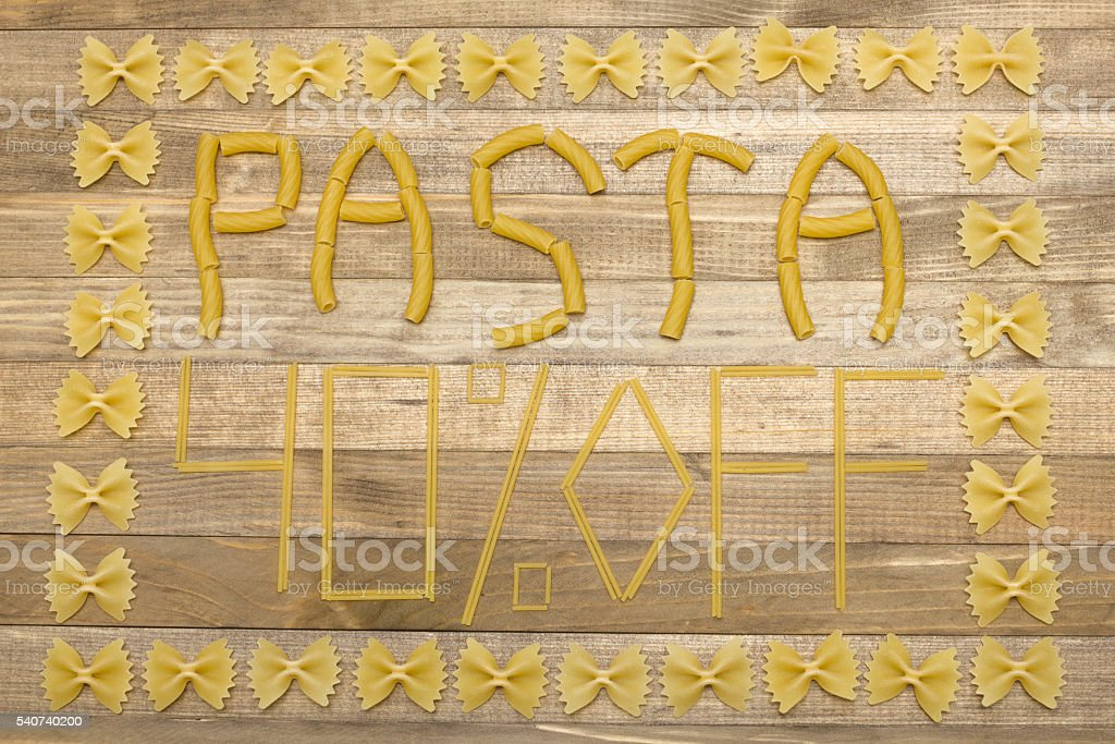 pasta  forty percent off text made of raw pasta stock photo