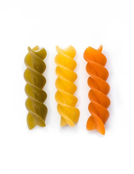 Pasta Fusilli Tri Color Pasta Fusilli Tri Color , isolated on a white background uncooked pasta stock pictures, royalty-free photos & images