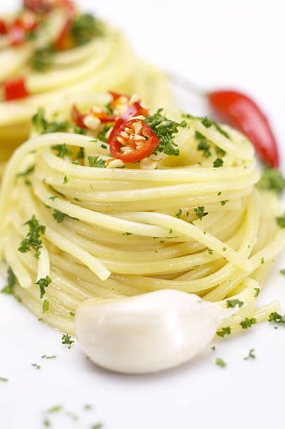pasta garlic extra virgin olive oil and red chili pepper stock photo