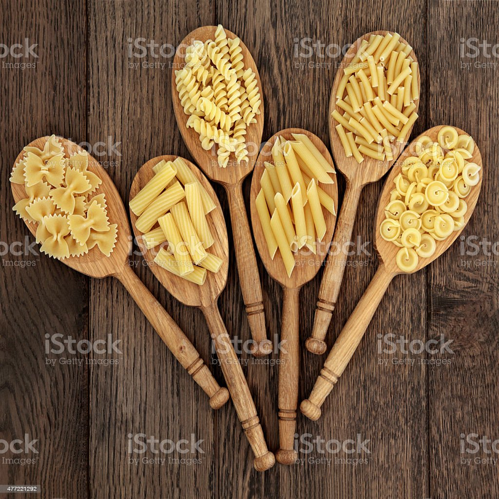 Pasta in Wooden Spoons stock photo