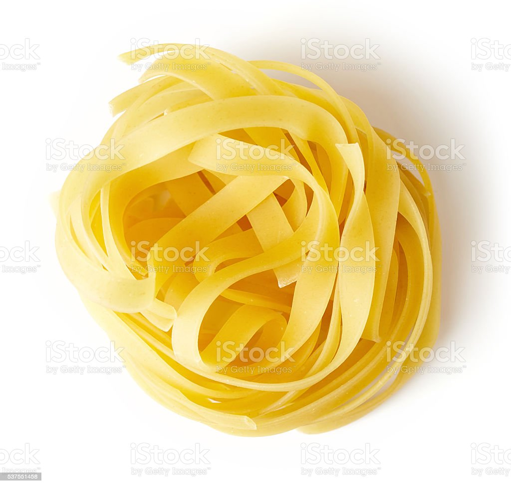 Pasta nest isolated on white, from above stock photo