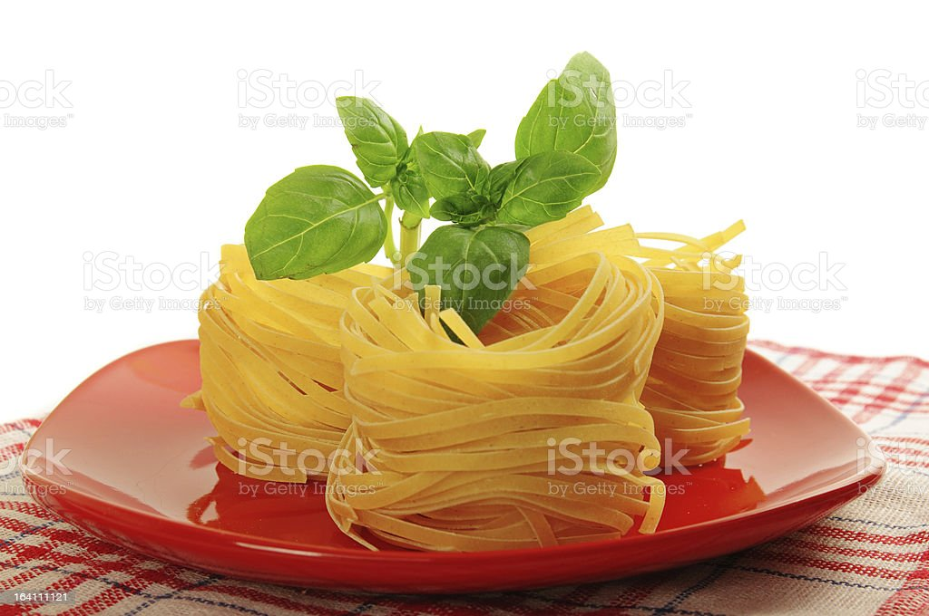 Pasta nests on a dish royalty-free stock photo