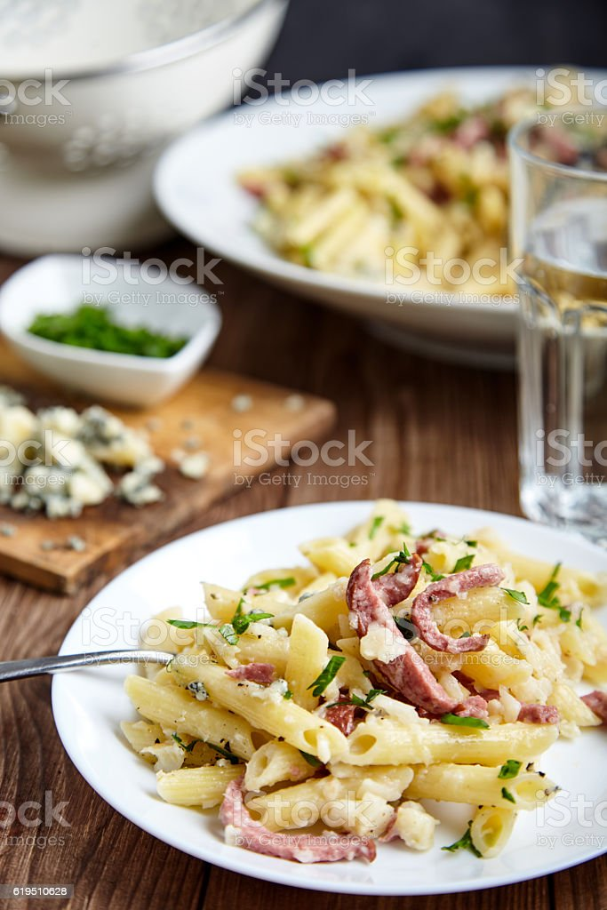 Pasta of Penne rigate, celery and smoked sausage stock photo