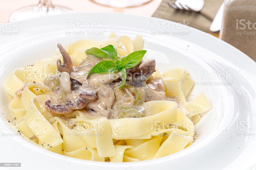 pasta or noodles, fresh basil stock photo