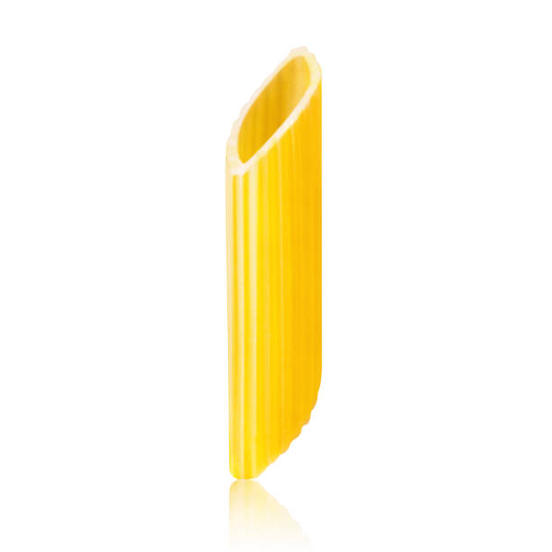 Pasta Penne One penne pasta isolated on white background rigatoni stock pictures, royalty-free photos & images