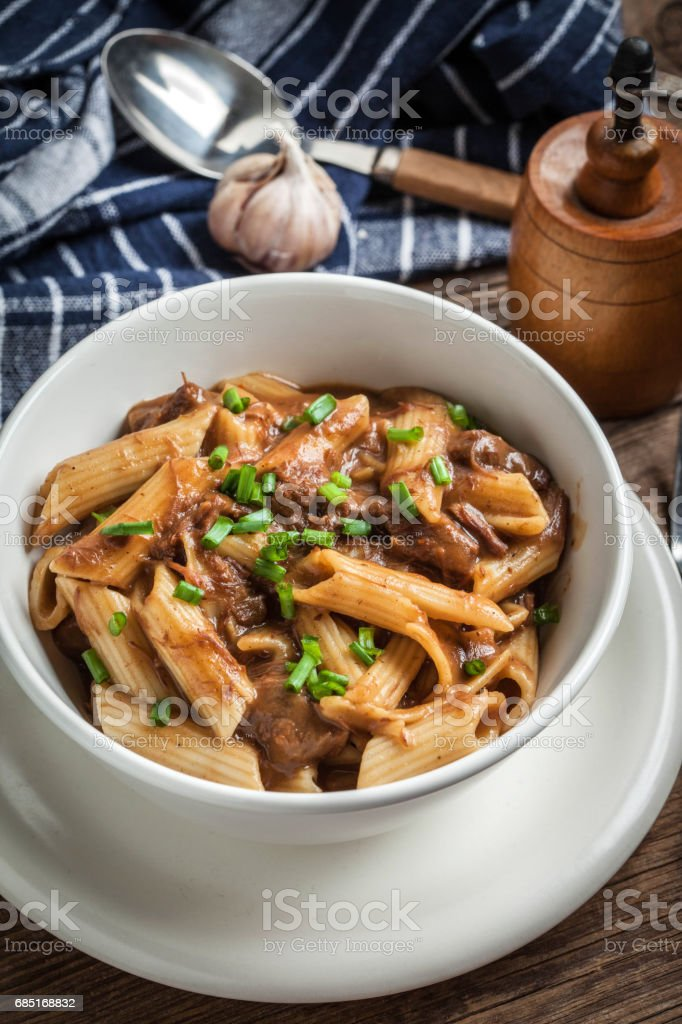Pasta penne with pork sauce. royalty-free stock photo