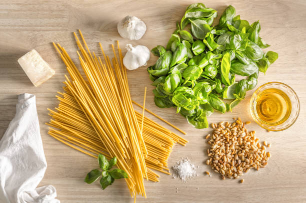 Pasta pesto genovese, spaghetti, garlic, basil, pine nuts, parmigiao, olive oil and salt stock photo