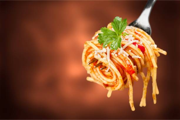 Pasta. Fork with just spaghetti around spaghetti stock pictures, royalty-free photos & images