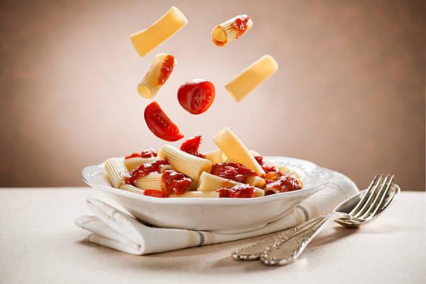 Pasta Macaroni pasta with tomato sauce close up macaroni stock pictures, royalty-free photos & images