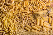 Variety of types and shapes of dry pasta