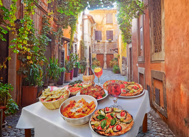 Pasta , pizza  and homemade food arrangement  in a restaurant  Rome stock photo