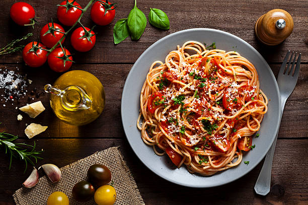 pasta plate - italian food stock photos and pictures