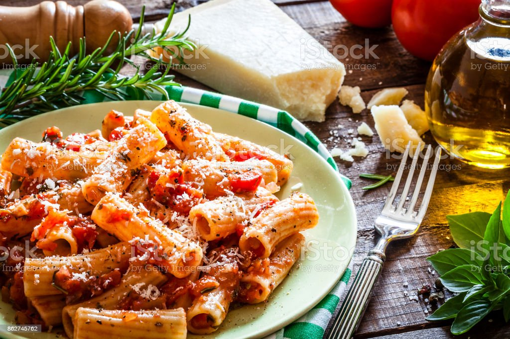 Pasta plate shot on rustic wooden table stock photo