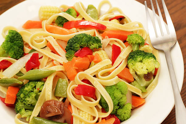 Pasta Primavera Fettuccine Pasta with garden fresh vegetablesPlease see some similar pictures from my portfolio: primavera stock pictures, royalty-free photos & images