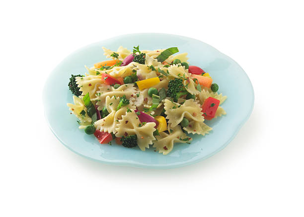 Pasta primavera Pasta primavera isolated on white background with soft drop shadow.  Large files come with clipping path. primavera stock pictures, royalty-free photos & images