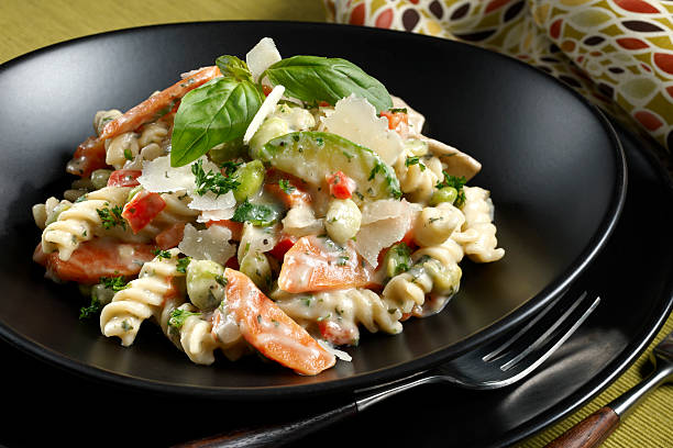 Pasta Primavera Pasta Primavera. Rotini pasta in a light cream sauce with carrots, zucchini, red bell pepper and edamame topped with shaved parmesan cheese and basil. See other pasta dishes in my