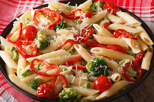 Pasta Primavera with vegetables close-up on a plate. horizontal Pasta Primavera with vegetables close-up on a plate on the table. horizontal primavera stock pictures, royalty-free photos & images