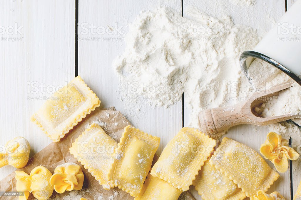 Pasta ravioli on flour stock photo