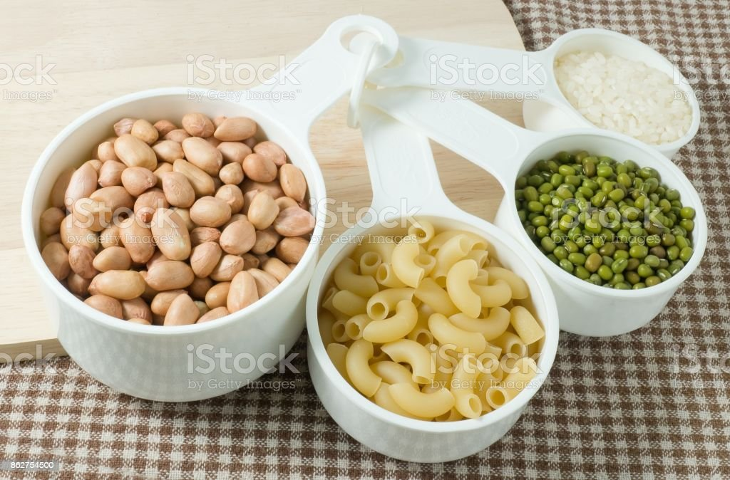 Pasta, Rice and Mung Beans in Measuring Spoons stock photo