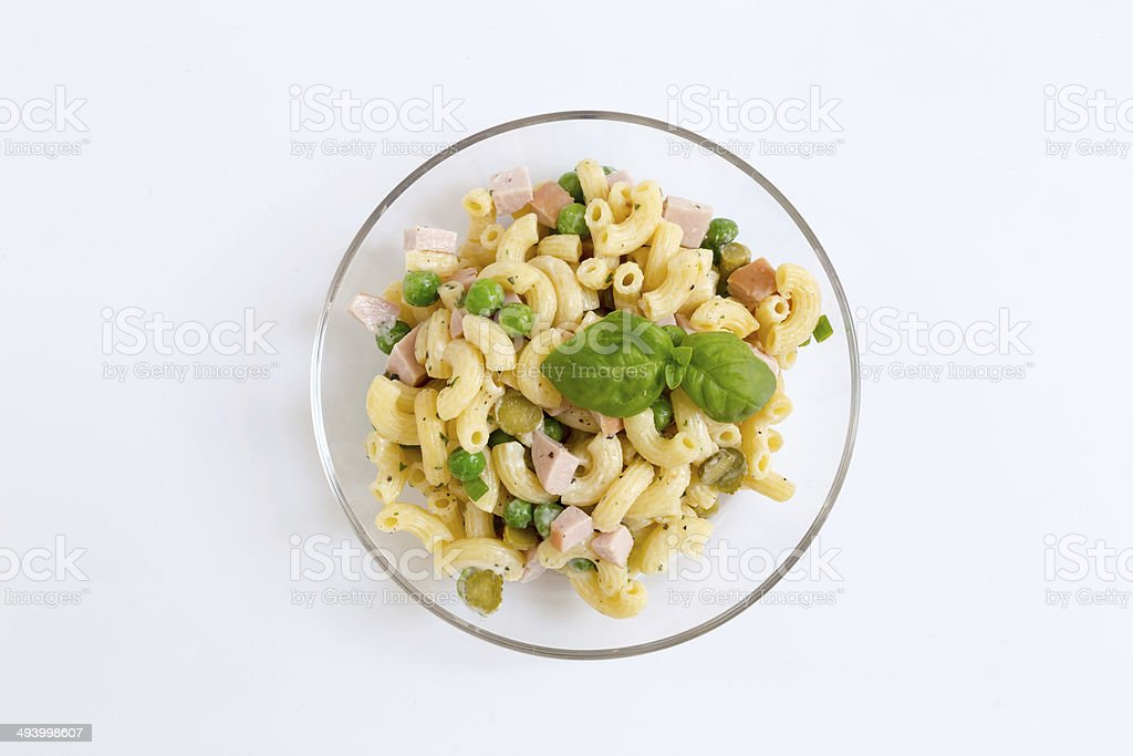 Pasta salad in a glass bowl as Cut stock photo