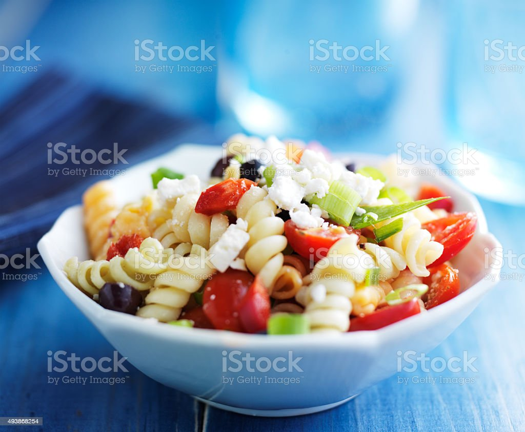 pasta salad with olives and feta cheese stock photo