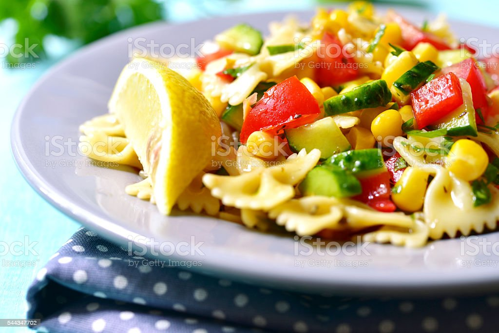 Pasta salad with tomato,bell pepper,cucumber and sweet corn. stock photo