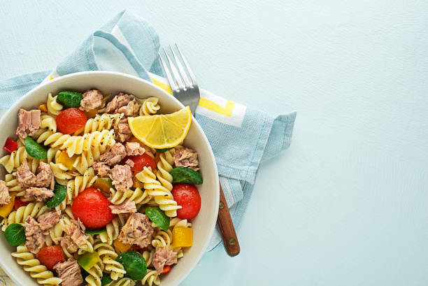 Pasta salad with tuna fish and vegetables stock photo