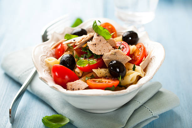 Pasta salad with tuna penne salad with tuna, olives and cherry tomatoes tuna animal stock pictures, royalty-free photos & images
