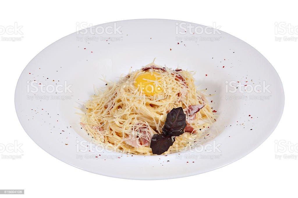Pasta Spaghetti alla carbonara with ham, cheese, Yolk on Top. stock photo