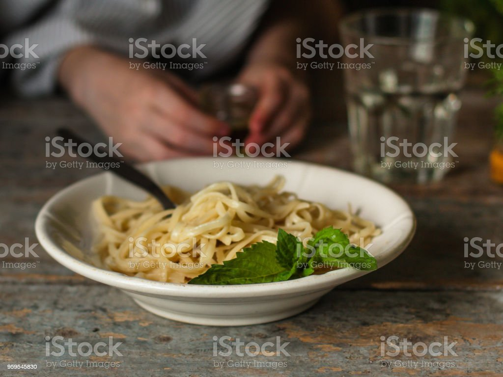pasta spaghetti in a white plate (food intake meal) - italian cuisine (long pasta).  Food background stock photo