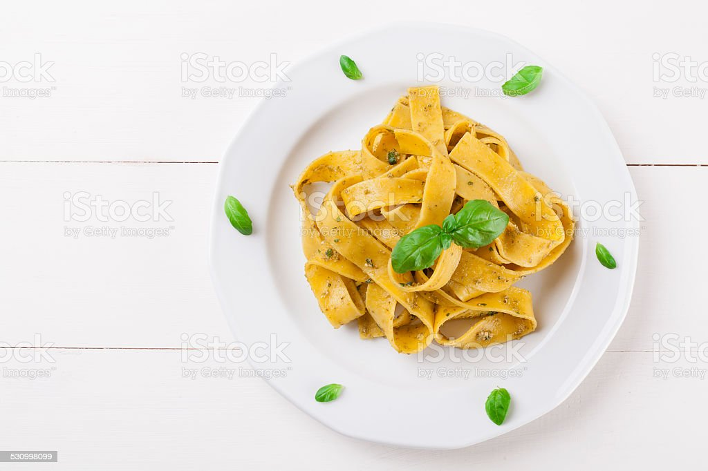 Pasta tagiatelle with pesto stock photo