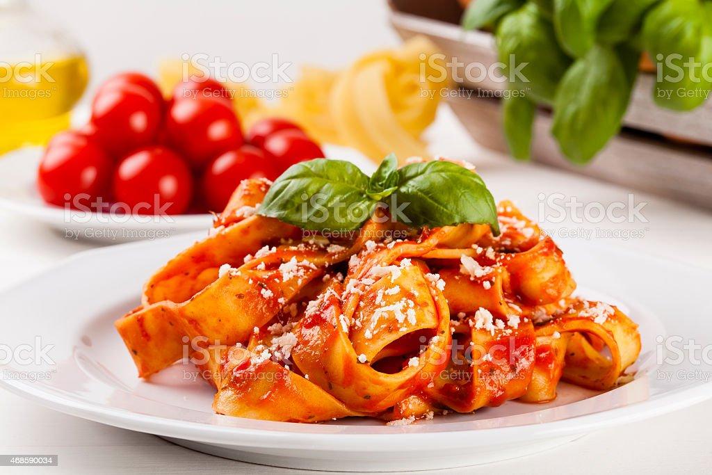Pasta tagiatelle with tomato stock photo