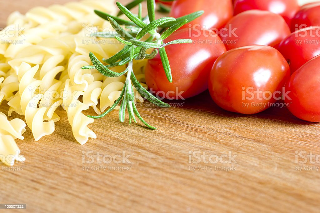 Pasta, tomatoes, and rosemary. stock photo