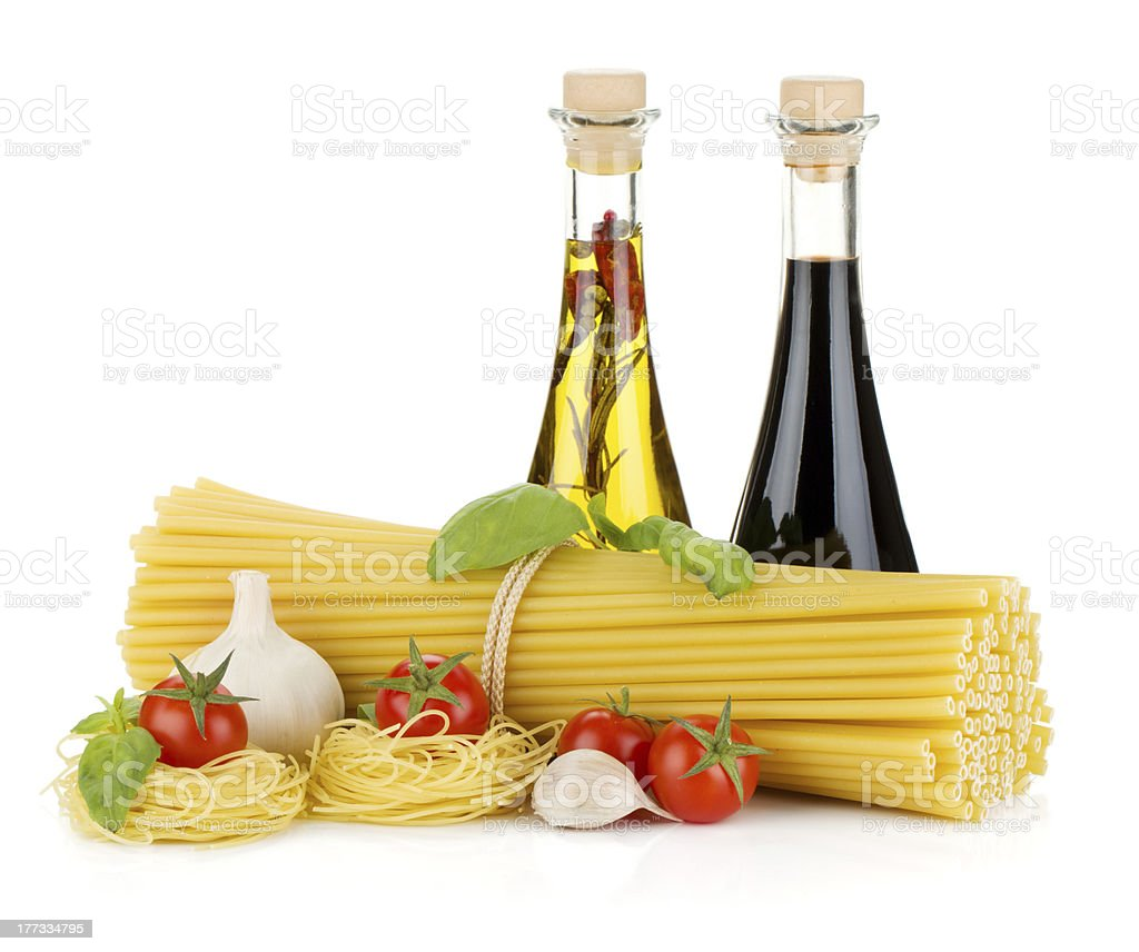Pasta, tomatoes, basil, olive oil, vinegar and garlic royalty-free stock photo